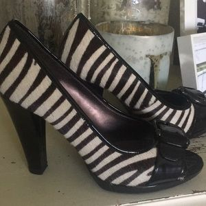 Isola patent and faux zebra skin heels. 9M